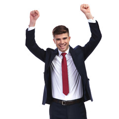 laughing businessman celebrating success with fists in the air