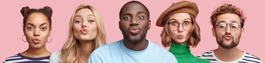 Portrait of two men and three women of different nationalities, keep lips rounded, make grimace at camera, isolated over pink studio background. People, diversity and facial expressions concept