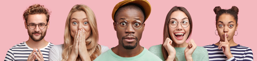 Horizontal shot of stupefied dark skinned male in spectacles, overjoyed Asian female clenches fists, African woman shows silence sign and bearded man with intriguing look isololated on pink background