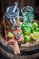 Bartender ingredients ready to make a drink on old barrel