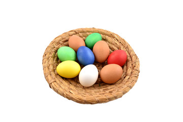 Basket with colored eggs stock images. Easter basket on a white background. Easter decoration photo. Wicker basket with egg. Easter concept