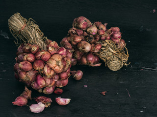 Closeup red shallot on dark background