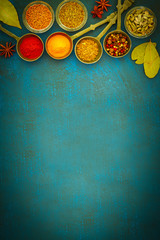 Zelfklevend Fotobehang Kruiden Wooden table of colorful spices