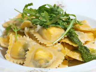 European cuisine ravioli with arugula