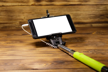 Monopod for selfie with smart phone on wood desk