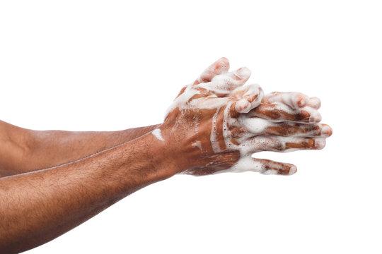Black man washing hands isolated on white background