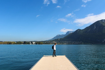 ANNECY, FRANCE - SEPTEMBER 22, 2012: Tourist walks on the pier in Annecy.