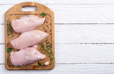 Raw chicken breast with spices