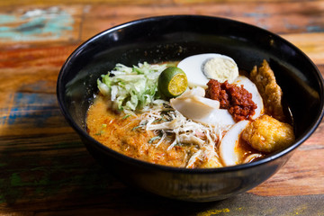 Serving of Nyonya Laksa, popular spicy noodle soup in Malaysia