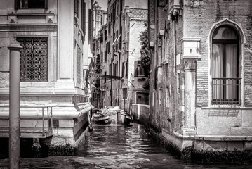 Narrow side street with a boat at Grand Canal, Venice