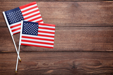 American flags on brown wooden table