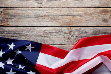 American flag on grey wooden table