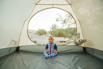 Happy boy in tent