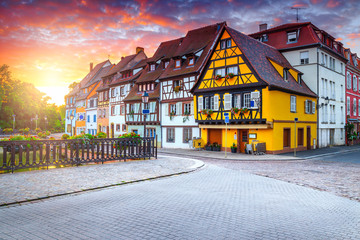 Fantastic medieval half-timbered facades and paved street, Colmar, France