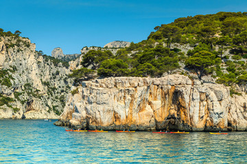 Colorful kayaks in the rocky bay, Calanques national park, France