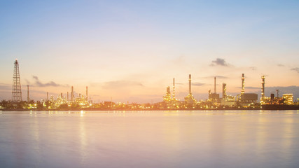 Panorama petrochemical refinery river front at twilight, industrial background