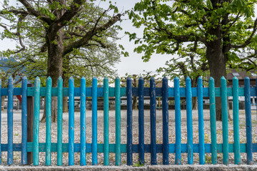 colorful wooden fence in different shades of blue