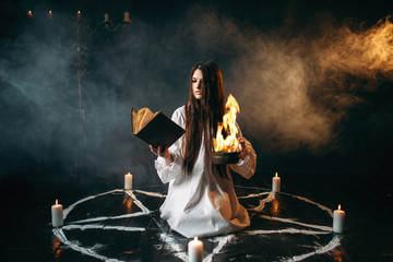 Witch in pentagram circle, dark magic ritual