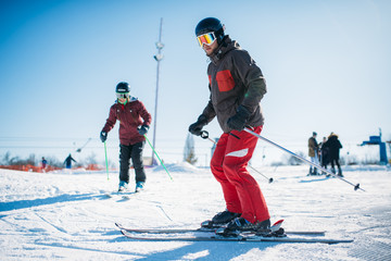 Beginners learn to ski, winter active sport