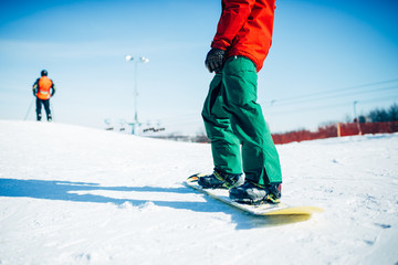 Snowboarder riding a snow hill, extreme sport