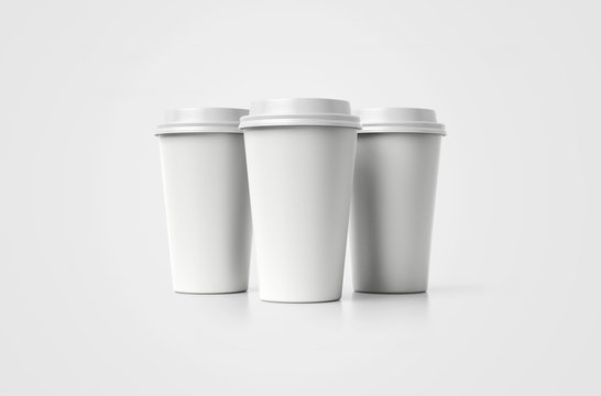 Coffe cup. White paper cup with a cover without label isolated on background. Take away beverage. Big cardboard cup of coffee to go isolated mockup.