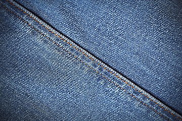 texture shabby blue denim with yellow stitched thread