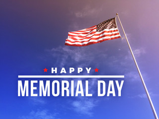 Happy Memorial Day Text Over Blue Sky Background with American Flag