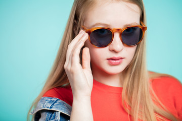 Close up shot of young woman in sunglasses