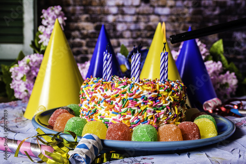 Candles Being Lit On Birthday Cake With Rainbow Sprinkles Blue Plate Party Hats