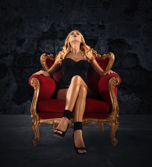 Sensual woman on a red velvet armchair