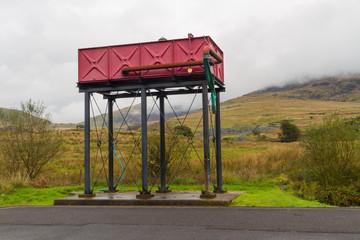 Steam engine water tower, red.