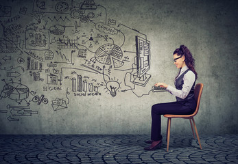 businesswoman working in an office brainstorming business plan