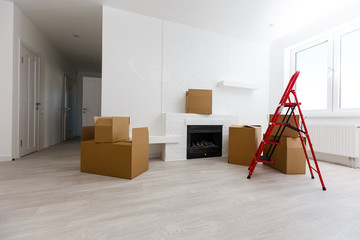 Ladders and boxes in new empty apartment