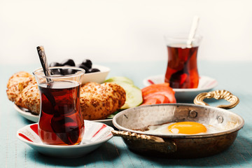 Traditional Turkish breakfast with fried eggs and tea