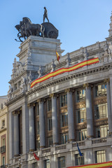 Building with Sculpture of a chariot at Alcala street in city of Madrid, Spain