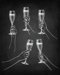 Set of hands with champagne glasses