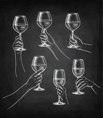 Set of hands with wine glasses