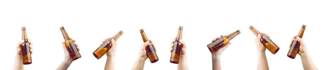 Foto auf Gartenposter Bier / Apfelwein Bunch Of Hands Holding Bottles Of Beer Up At Party Giving A Cheers Isolated On White Background
