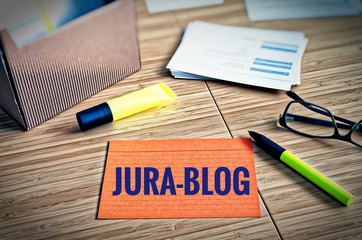 Index cards with legal issues with glasses, pen and bamboo with the german word Jura-Blog in english Law-Blog