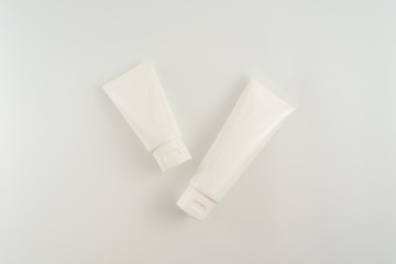 White cosmetic tube on white background. Natural beauty blank label for branding mockup concept.