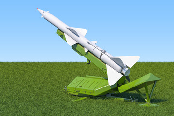 Missile defence system on the green grass against blue sky, 3d rendering