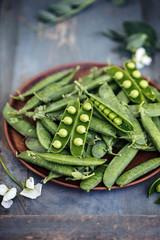 Green pea in plate, rustic toning