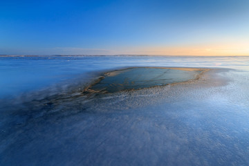 spot dawn on a frozen lake / icy landscape Ukraine winter