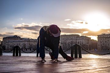 man acrobatic move freeze in the city close up portrait