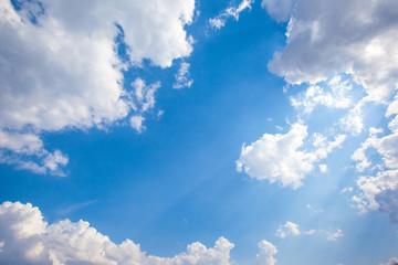 Big white cumulus cloud against blue sky