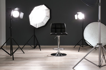Modern chair in photo studio with professional equipment
