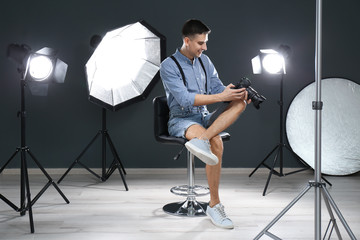 Young photographer working in professional studio
