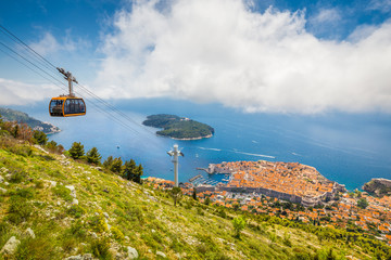 Wall Mural - Old town of Dubrovnik with cable car ascending Srd mountain, Dalmatia, Croatia
