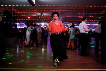 Han Min-ja dances at the New Hyundai Core colatec in Seoul