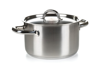 Open stainless steel cooking pot with lid over white